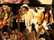 Brad Whitford, Steven Tyler, and Joe Perry of Aerosmith performing at the NFL Kickoff in Washington, DC on September 4, 2003.