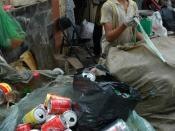 A smiling boy recycling garbage in Saigon.