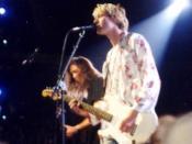 Kurt Cobain (front) and Krist Novoselic (left) live at the 1992 MTV Video Music Awards.