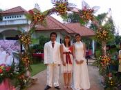 English: Wedding photograph (Net [groom], Nusscharin of the bride and Jinda [bride]). Na Khun Yai, Thailand.