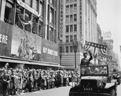 General George S. Patton acknowledging the cheers of the welcoming crowds in Los Angeles, CA, during his visit on June 9, 1945. Acme. (OWI) NARA FILE #: 208-PU-154F-5 WAR & CONFLICT #: 753 Location: LOS ANGELES, CALIFORNIA (CA) UNITED STATES OF AMERICA (U