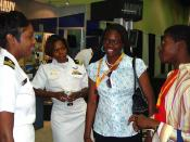 US Navy 070708-N-2888Q-005 Lt. Ladonna Gordon (left), and Lt. Kathryn S. Wijnaldum, Recruiters in the Detroit area, talk with two high-school seniors at the 98th National Association for the Advancement of Colored People (NAACP