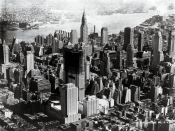 Looking east as Rockefeller Center, under construction, rises in mid-Manhattan in 1932. Chrysler Building in background
