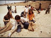 EIGHTH GRADE STUDENTS FROM ST. BONAVENTURE HIGH SCHOOL SPEND RECESS PERIOD PICKING UP LITTER ON BEACH NEAR OIL WELLS - NARA - 542657