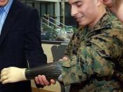 English: American actor Owen Wilson gripping Lance Cpl. Brandon Mendez's new myoelectric arm.