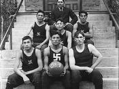 Chilocco Indian Agricultural School Basketball team on Home 1 Steps, 1909. This photograph is part of a series of glass plate negatives used by the Chilocco Indian School print shop in publishing the Indian School Journal.