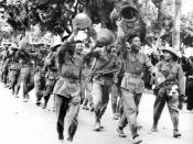 English: 9 October 1954. Waving to the city populace, joyous Viet Minh troops enjoy a parade of victory through the streets of Hanoi