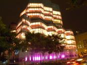 English: Looking southeast from bike path, across 19th and West Side Highway, at IAC building after dark.
