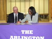 English: ARLINGTON, Va. (April 14, 2010) Steffanie Easter, Assistant Deputy Chief Of Naval Operations For Manpower, Personnel, Training And Education, signs a personal excellence partnership agreement with the Arlington Career Center. The agreement will p