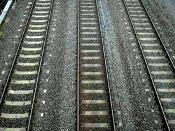 English: Railway tracks. (NOTE: Uploader says, in upload message, that this is his own photo. Also, he says that his uploaded images are PD, on this page: en:User:G-Man/photo_gallery, so I changed the tag from unverified to PD. Have notified uploader. Thi