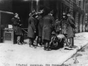 English: Firemen looking down hole in sidewalk, searching for victims of the Triangle Shirtwaist Company fire, New York City.