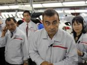 English: Carlos Ghosn answering reporters' questions at the Nissan factory in Kyushu, Japan. Picture by Bertel Schmitt