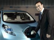 English: Nissan CEO Carlos Ghosn charges a Nissan Leaf, the first mass-produced zero-emission vehicle.