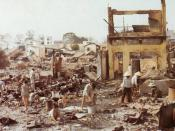 Civilians sort through the ruins of their homes in Cholon, the heavily damaged Chinese section of Saigon