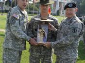Staff Sgt. Michael Johnston from Fort Benning, Ga., won the active-duty 2009 Drill Sergeant of the Year title at Continental Park on Fort Monroe, Va. Johnston is presented with the Drill Sergeant of the Year trophy by Command Sgt. Maj. David Bruner and Ge