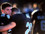 Military Photographer of the Year Winner 1998, Title: Numb After Loss, Category: Sports, Place: Second Place Sports/First Place Portfolio. Centreville High School defensive back Josh Mosser is numb after his team loses to a rival in the VHSL Group AAA div