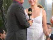 Julia Stiles being interviewed by Entertainment Tonight's Mark Steines at the Bourne Ultimatum premiere at the Cinerama Dome in Hollywood, CA on July 25, 2007.