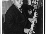 Fats Waller, three-quarter length portrait, seated at piano, facing front / World Telegram & Sun photo by Alan Fisher.