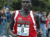 Robert Cheruiyot in 2006 Boston Marathon as he passes through Wellesley Square.