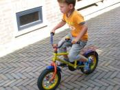 English: child on a bicycle