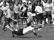 A Japanese player makes a layout grab en route to winning the World Women's Ultimate Championship final versus Sweden in 1992.
