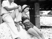 Morante with Alberto Moravia at Capri in the 1940s.