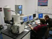 Students working on a Scanning Electron Microscope (SEM) Leo Supra 35