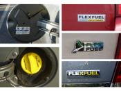 E85 sticker in the back of the fuel filler door (left top) + E85 bright yellow gas cap (left bottom) + Three typical U.S. commercial E85 flexible-fuel badges from Chrysler (top right) Ford (middle right) and GM (bottom right)