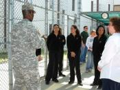 GUANTANAMO BAY, Cuba – Members of the Atlanta Falcons cheerleading squad tour Camp 5 here, Jan. 26, 2009. Camp 5 is a maximum security facility modeled after an existing facility in the United States.