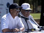 Golfer Tiger Woods, left, answers questions about his week-long Army experience at Fort Bragg, during a press conference there April 16 after a youth golf clinic. Woods took part in a variety of training events, including a jump from an airplane. Beside W
