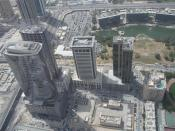 This is a photo showing Dubai Media City in Dubai, United Arab Emirates as seen from the air on 1 May 2007. The main buildings in Dubai Media City are the three buildings in the upper right. New skyscrapers within Dubai Media City are in the center of the