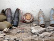 Original caption:Iraqi Police discovered this improvised explosive device Nov. 7 (2005) in eastern Baghdad and disarmed it before it could be detonated in a terrorist attack. Army photo. The IED comprises 4 large artillery shells plus an anti-tank mine, a