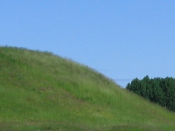 Finds from Eadgils' mound, left, excavated in 1874 at Uppsala In Sweden supported Beowulf and the sagas. Ongenþeow's barrow, right, has not been excavated.