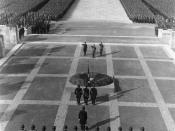 Hitler (center, in front of the wreath), Lutze (on Hitler's left), and Himmler (on Hitler's right), making a Nazi salute in front of the World War I cenotaph in the 1934 Nuremberg rally.