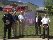 "English: Denver, CO, May 21, 2004 -- Homeland Security Under Secretary and director of FEMA Michael D. Brown poses with firefighters at the national roll-out of FEMA's fire book ""At Home In The Woods, lessons learned in the wildland/urban int"
