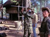 John Wayne with George Takei at a staged South Vietnamese village on Fort Benning, Georgia
