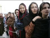 Women of Afghanistan stand outside the U.S. Embassy in Kabul, Wednesday, March 1, 2006. President George W. Bush and Laura Bush made a surprise visit to the city and presided over a ceremonial ribbon-cutting at the embassy.
