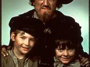 Clockwise from left: Mark Lester as Oliver, Ron Moody as Fagin and Jack Wild as the Artful Dodger.