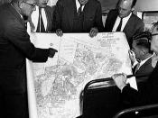 The original architects of apartheid gathered around a map of a planned township.