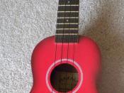 English: A red Ukulele, manufactured by Makala