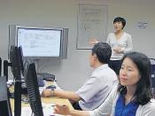 English: Hyesoon Kim, cataloguer and librarian at Fort Belvoir's Van Noy Library, traveled to Yongsan, Korea, recently, to train other FMWR librarians and employees. Kim trained from Yongsan Library to Korean and American library employees from throughout