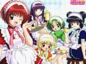 The five girls who make up Tokyo Mew Mew as seen in their Cafe Mew Mew uniforms in the anime adaptation. From left to right: Ichigo Momomiya, Zakuro Fujiwara, Pudding Fong, Lettuce Midorikawa, and Mint Aizawa.