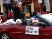 English: Michael Ignatieff at the Lakeshore Santa Claus Parade with his two children