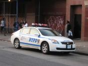English: New York City Police cruiser #5010, a Nissan Altima hybrid is parked in Jamaica, New York.