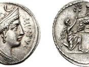 Denarius coin, Reverse: Sulla seated left on a raised seat; before him kneels Bocchus, offering an olive-branch; behind, Jugurtha kneeling left, 56 BC.