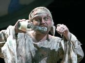 English: Caliban (Todd Scofield) has a conversation with his imaginary friends, Trinculo and Stephano, in Folger Theatre's production of Shakespeare's The Tempest in 2007.