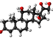 Ball-and-stick model of the cortisol molecule, a steroid hormone that controls the body's response to stress. Colour code (click to show) : Black: Carbon, C : White: Hydrogen, H : Red: Oxygen, O