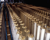 Cascades of gas centrifuges are used to enrich uranium ore to concentrate its fissionable isotopes.