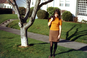 Young woman in fashion of the era standing by sidewalk. Taken In 1966 in Eugene, Oregon (USA)