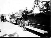Admiral Robison and other US Navy officers seated in a procession of cars near Fort Macquarie